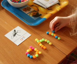 Spelling using star beads and free printables (Photo from Explore and Express)