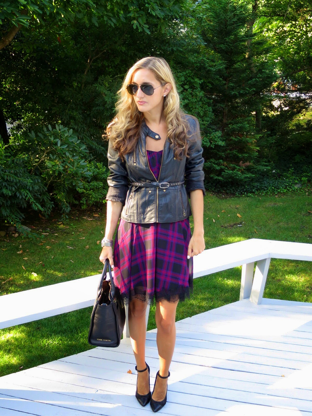 leather jacket over plaid dress