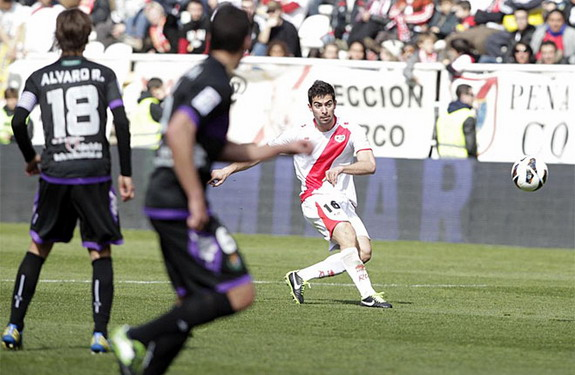 Rayo Vallecano player Jordi Amat kicks the ball to score from halfway line against Valladolid