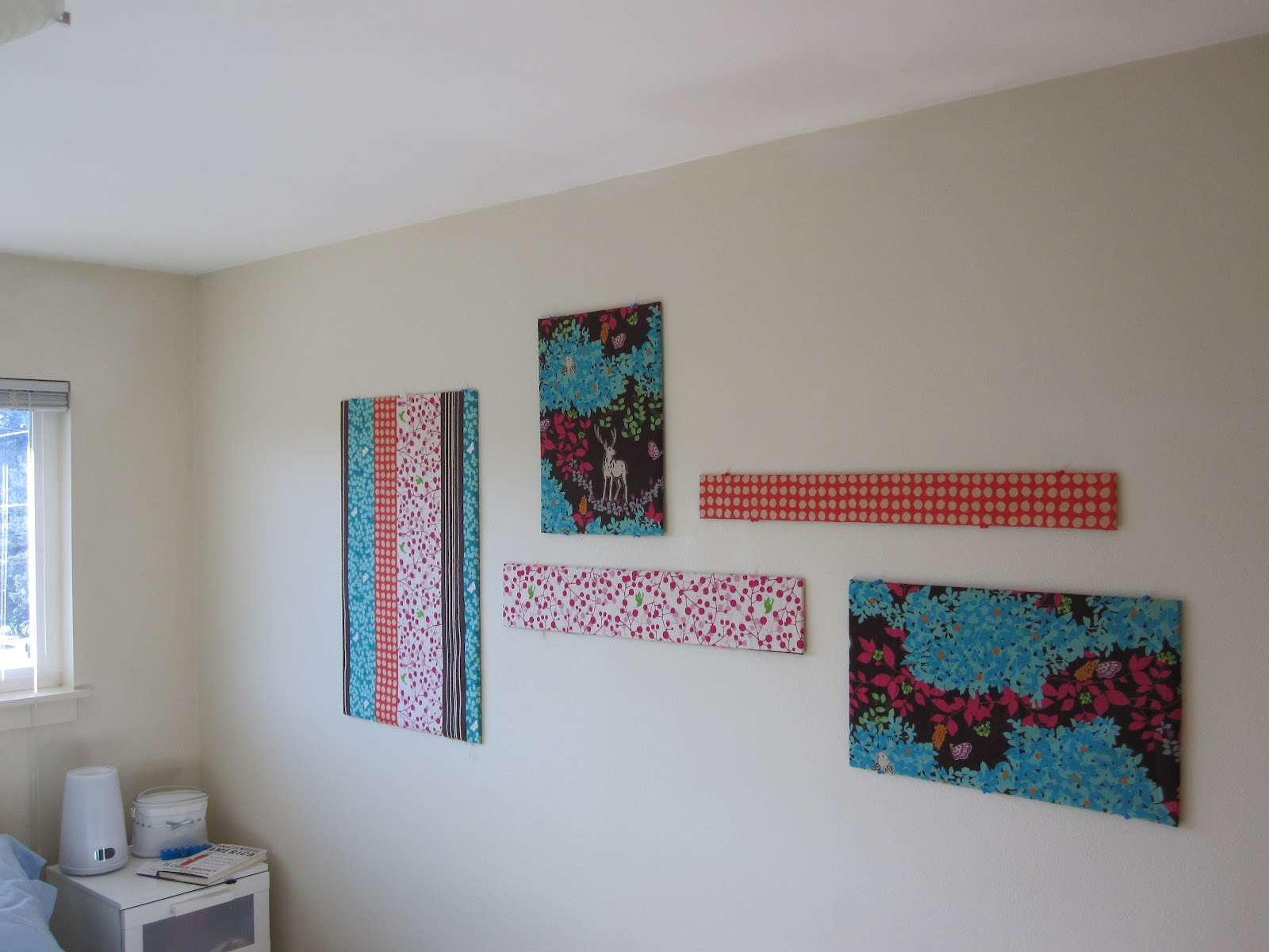 Inexpensive Fabric Wall Art. Decorating an apartment on the cheap is  difficult, especially since I'm mostly over the  posters-and-photos-without-frames look ...