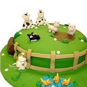 green cake decorated with animals