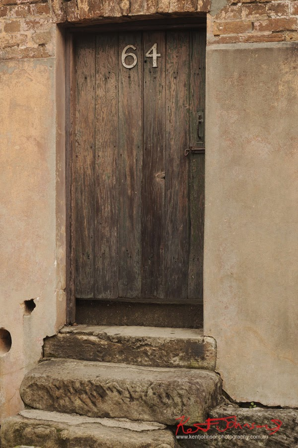 Old door in wall, The Rocks Sydney - Photographed by Kent Johnson.