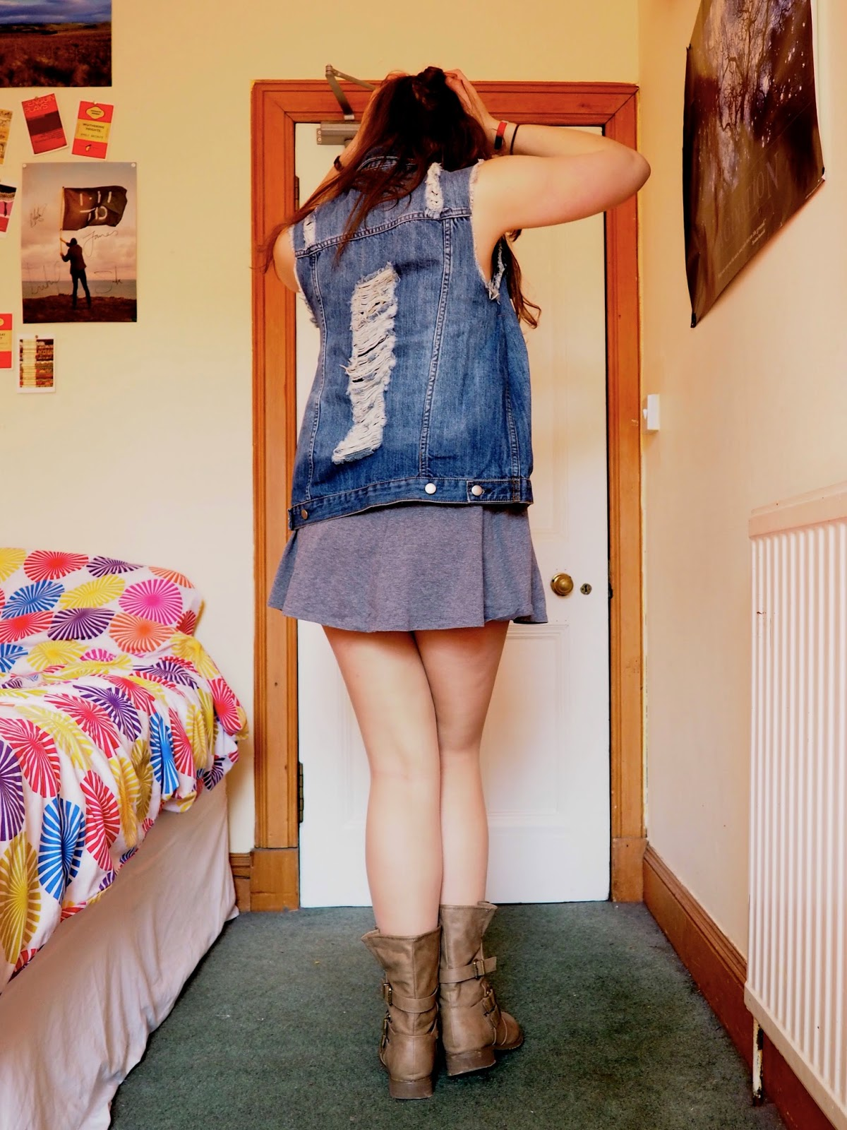 Distressed Denim outfit   ripped denim vest, short grey dress, brown studded boots