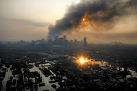 New Orleans flooded and burning, the week after Hurricane Katrina. (Credit: Vincent Laforet/NYT/Redux/Eyevine) Click to Enlarge.