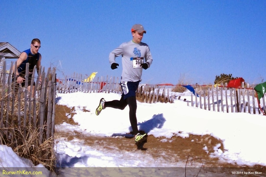 Running on the beach!  This runner FLYING over sand and snow at the Frosty Knuckle 5K in Salisbury, MA.
