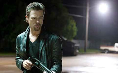 Brad Pitt as Jackie Cogan, fires his gun,, Killing Them Softly, Directed by Andrew Dominik