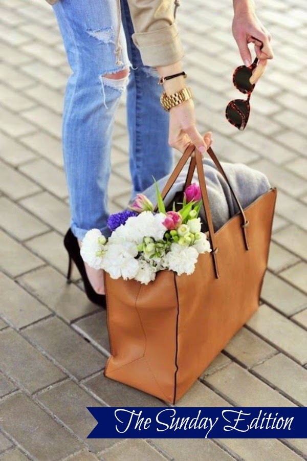 distressed jeans, leather tote, and fresh flowers