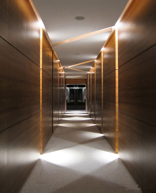 Picture of long hallway with wooden walls and creative lightning