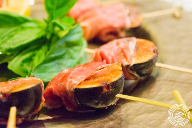 image of prosciutto wrapped figs at Osteria Del Circo in NYC, New York
