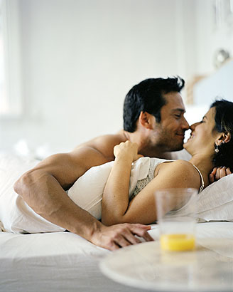 people kissing in bed on the lips