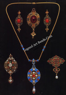 "A group of ""Holbeinesque"" jewels in enameled gold. Three pendants, a necklace, and a pendant en suite, plus a pair of earrings, all in the typical taste of the 1870s. The central pendant in the top row is similar to surviving examples cased for Hancock's. Courtesy S.J. Phillips Ltd, London"