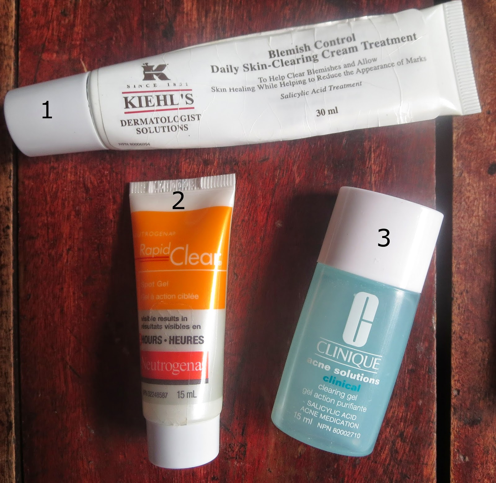a picture of Kiehl's blemish control skin clearing cream, neutrogena rapid clear, clinique acne solutions clearing gel