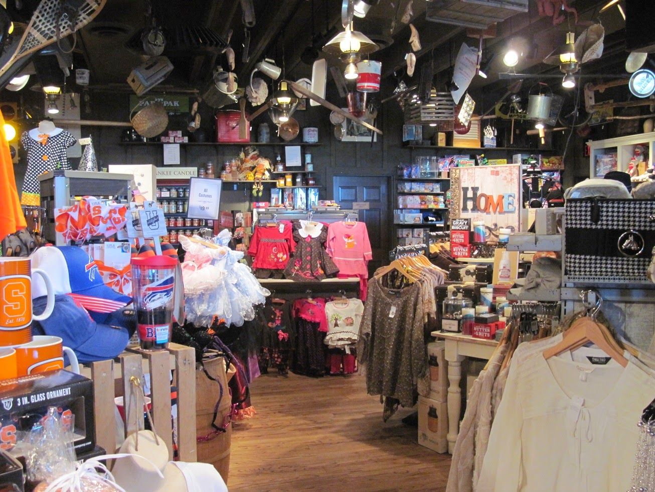 the old country store portion of a cracker barrel restaurant features clothing household decor gifts and a variety of well known food and candy