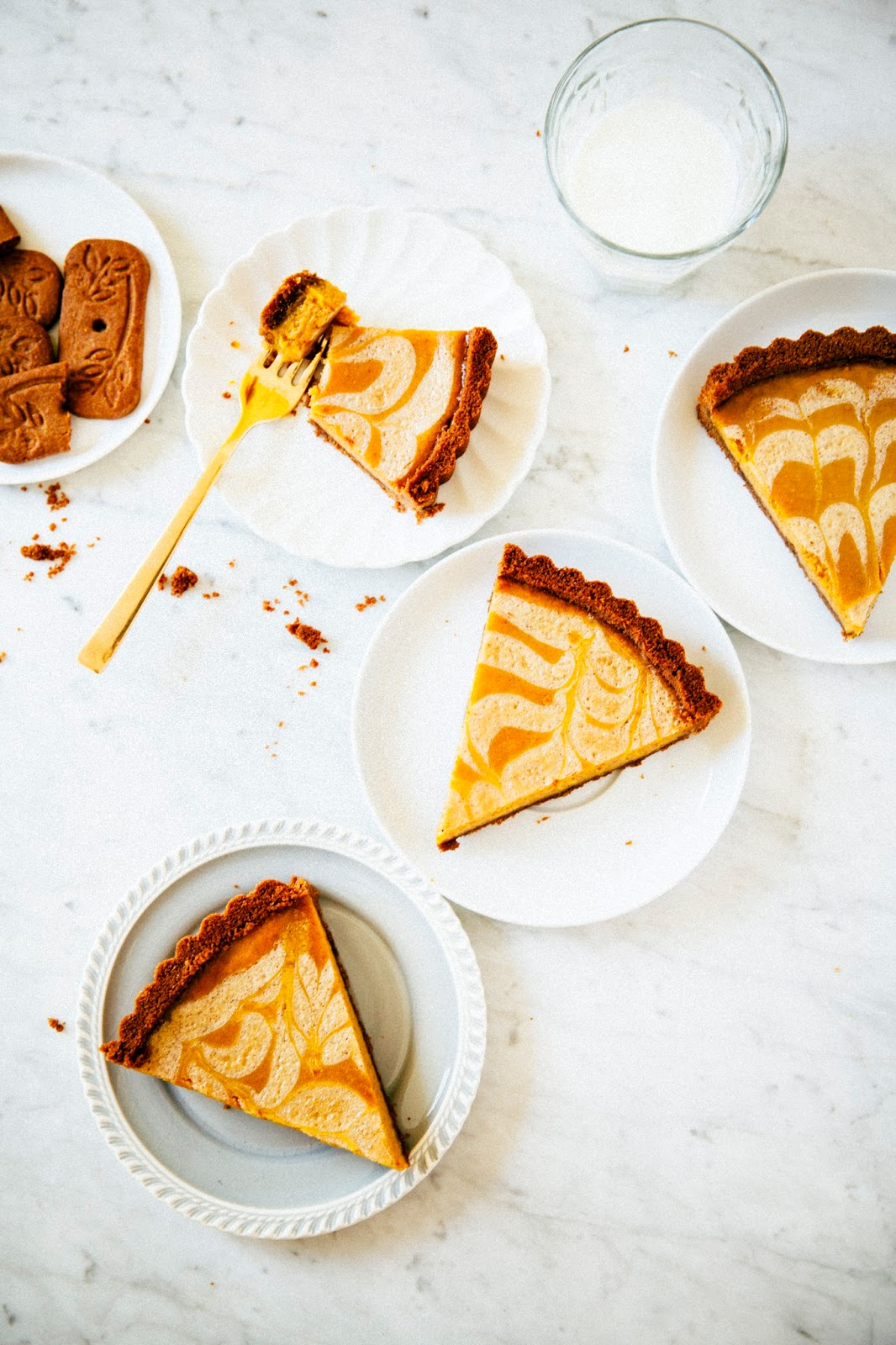 pumpkin pie with a speculoos cookie crust and a crème fraîche swirl ...