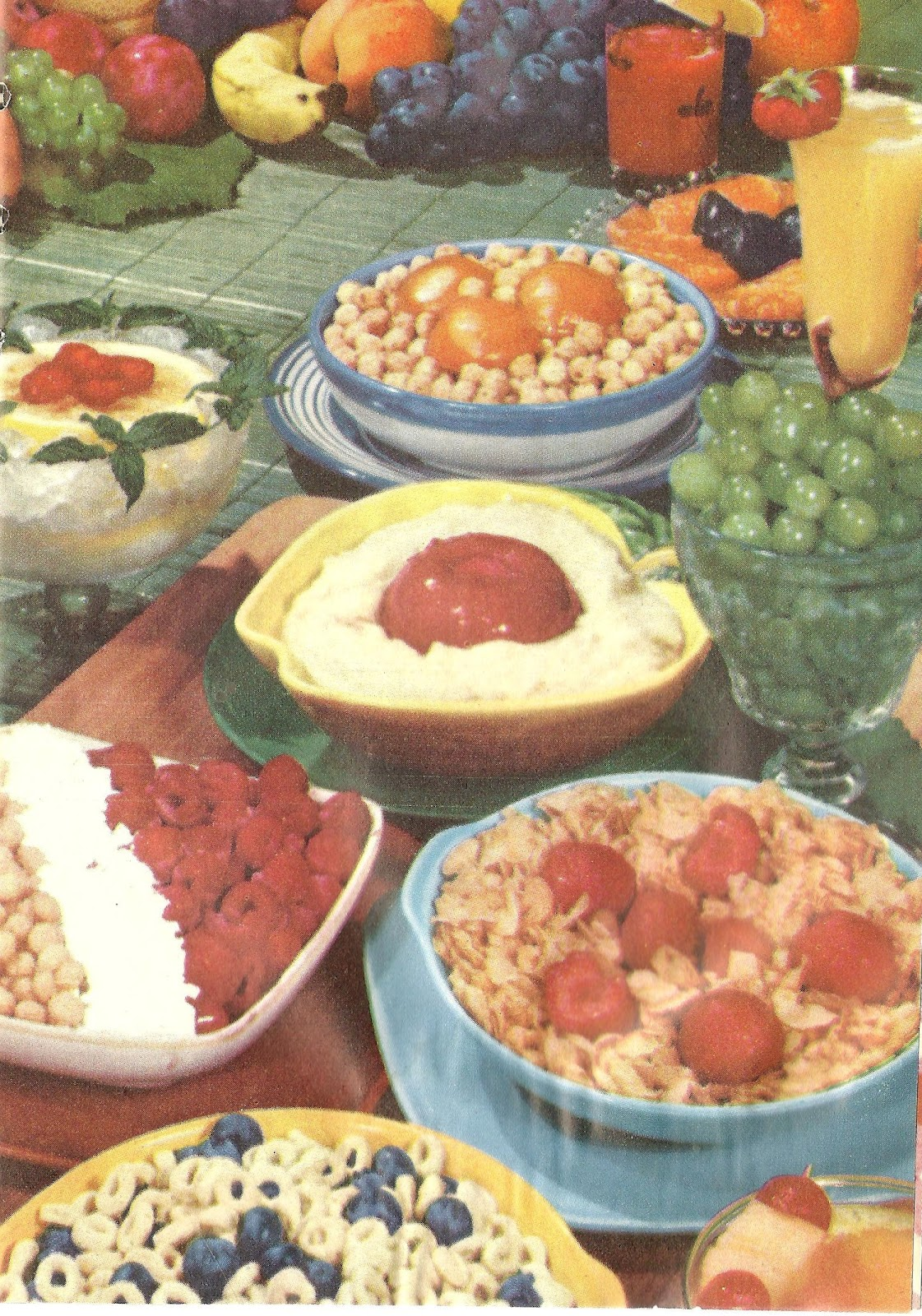 what a fine breakfast feast cereal with various fruits what looks like gruel with a blood clot on top of it orange juice served all fancy in a glass - Buffet Retro Cuisine