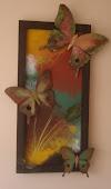mariposas de latón: elaborado en latón y madera,medidas 40 cm por 60 cm