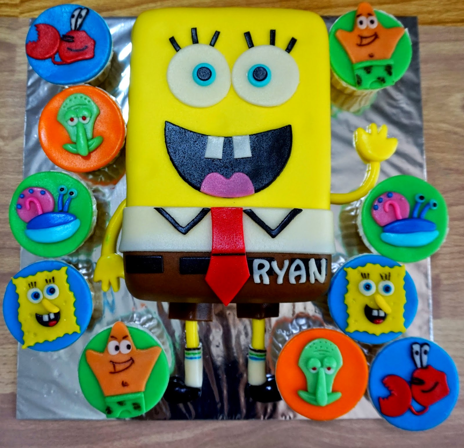 Sherbakes Spongebob Cake and cupcakes