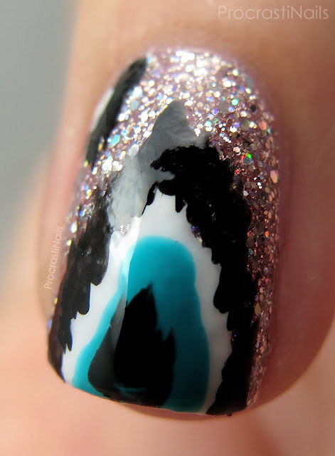 Macro of ikat nail art featuring Julep Yumi and Essie Point of Blue