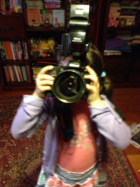 Alice holding ginormous camera