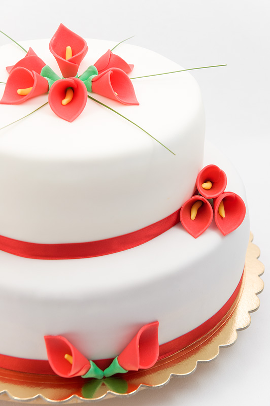 Red calla lily wedding cake fondant chocolate and peach cake side focus on lily