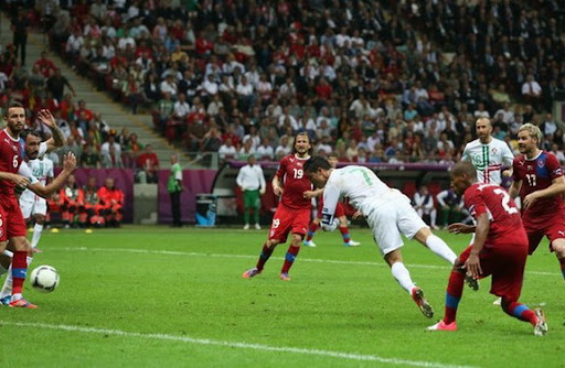 Portuguese forward Cristiano Ronaldo heads the ball to score the winner against Czech Republic