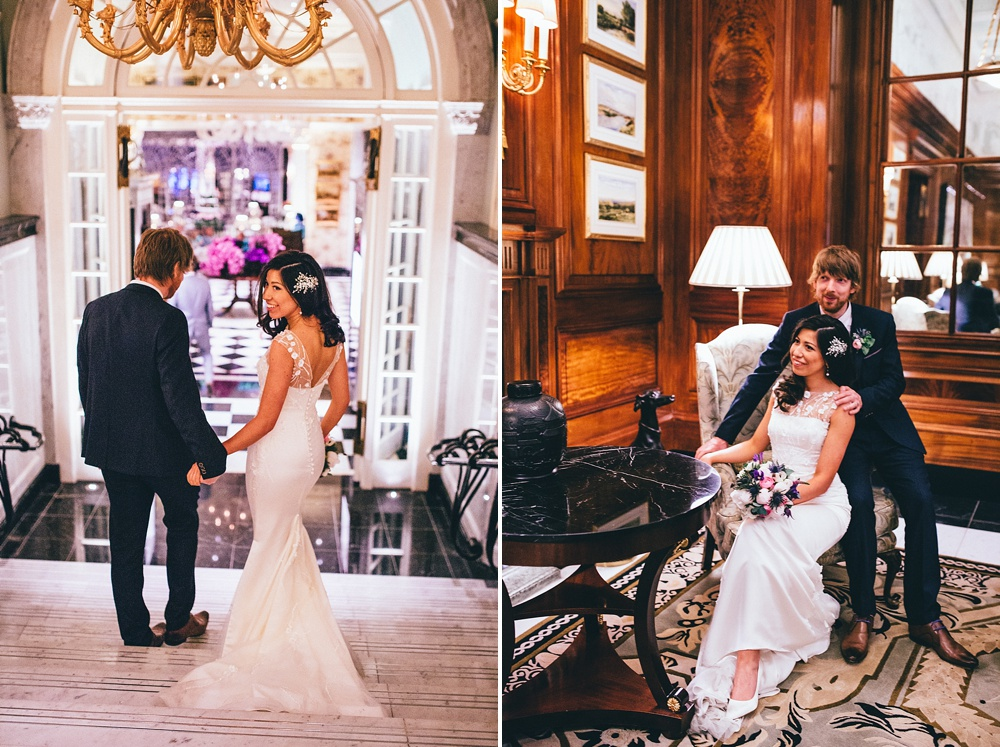 bride and groom pose for photographs in the savoy hotel where their wedding reception is held. Beautiful wedding photography.