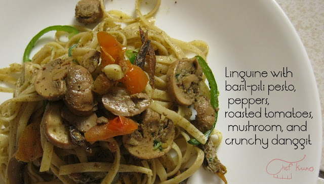 Linguine with basil-pili pesto, peppers, roasted tomatoes, mushroom and crunchy danggit