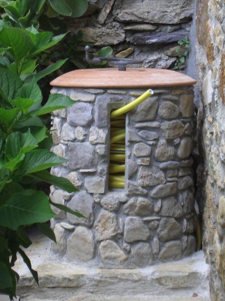 Arte in pietra fontane in pietra for Rocce per giardino prezzi