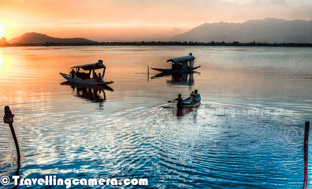 Dal Lake is an amazing place in Srinagar with some miraculous stuff around it and beauty gets enhanced during golden hour.  This PHOTO JOURNEY shares some of the golden hour moments at Dal Lake in Kashmir...Few days back we had shared same photographs in Black and White. So folks asked for colored versions as well. Please have a look at Black & White version as well and share your opinion colored vs B&W.There is another lake near to Dal Lake, which was closer to our Hotel Centaur - Nagin Lake. Nagin Lake got its name from the trees surrounding the lake. Popularly known as the 'Jewel in the Ring', it is one of the impressive lakes in east Srinagar. Nagin lake with its deep blue waters is separated from the Dal Lake by a thin causeway and is an exciting tourist spot with number of houseboats dwindling in the calm waters.Nagin Lake is a perfect place to go for swimming as it is less crowded and deeper. Water Skiing & sailing on fiberglass boats can also be enjoyed here. May to September is considered to be the best time to visit here. Hazratbal Mosque is a close by attraction to visit... The lake is bounded by the Shankaracharya hill (Takht-e-Suleiman) on the south and Hari Parbat on the west and is located at the foot of the Zabarwan hills. Willow and poplar trees flank the edges of the lake.Around the lake, there are various points to hire Shikaras for quick rides to other ends of the lake or exploring some of the interesting stuff around Lake. Shikara Ride is must while in Shrinagar and stay in Houseboats can be a wonderful experience. Various Houseboats can be seen around the shorlines of these Lakes in Kashmir.Srinagar city is located on both the sides of the Jhelum River which is called Vyath in Kashmir. The river passes through the city and meanders through the valley, moving onward and deepening in the dal Lake. The city is famous for its nine old bridges, connecting the two parts of the city.My friend Varun waiting for me to stop Click-Click and head towards o