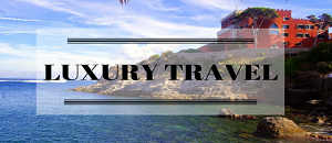 Luxury travel written across a hotel by the sea
