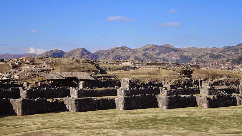 Sacsayhuamán also known as Saksaq Waman, is a walled complex located on the northern slopes of the city of Cusco. It is often described as a fortress since it is enclosed by three slopes and has a series of parallel walls that zigzag and would expose the flanks of invaders.