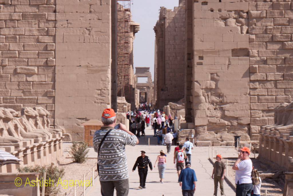Tourists entering the main route for the Karnak temple in Luxor
