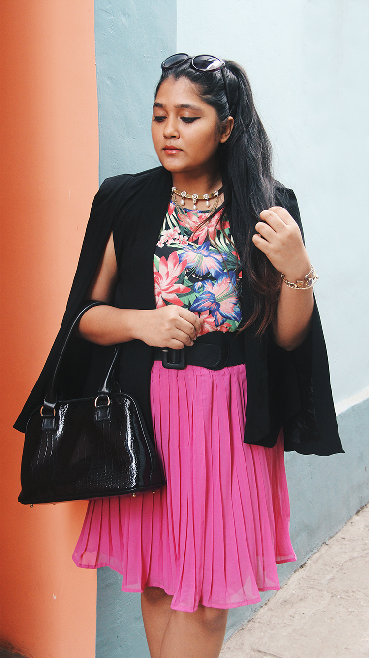 Indian fashion blogger in a cape blazer with pleated skirt
