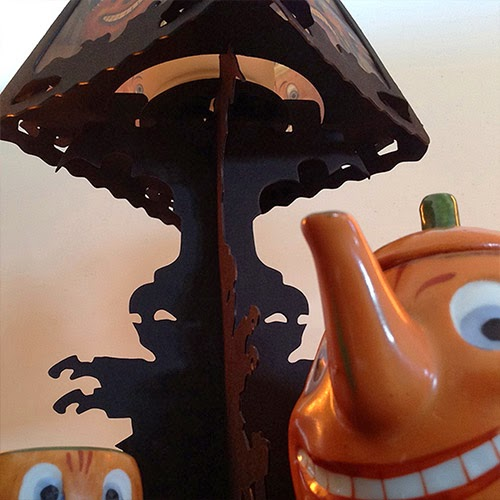Close-up Halloween Teapot with Cup under black table lantern by designer Bindlegrim