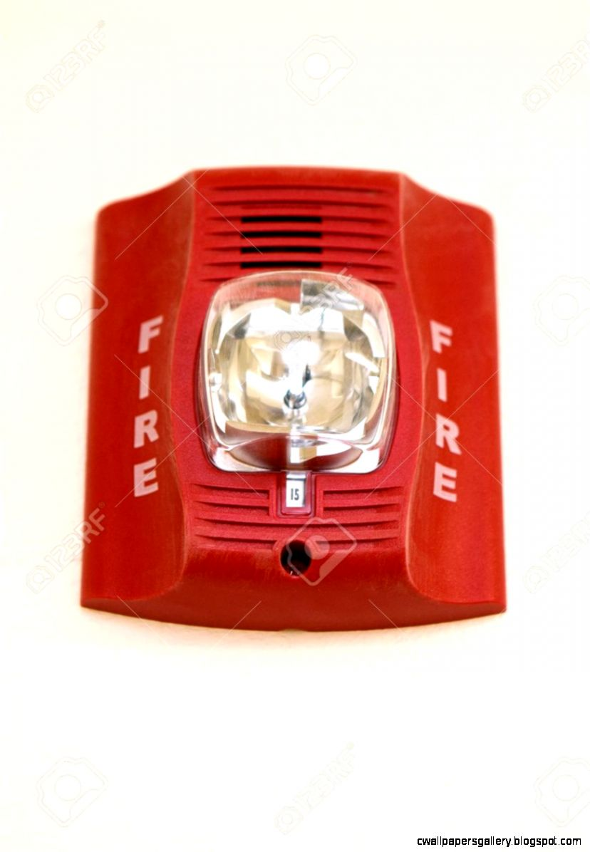 A Red Fire Alarm Hangs In An Apartment Building Stock Photo