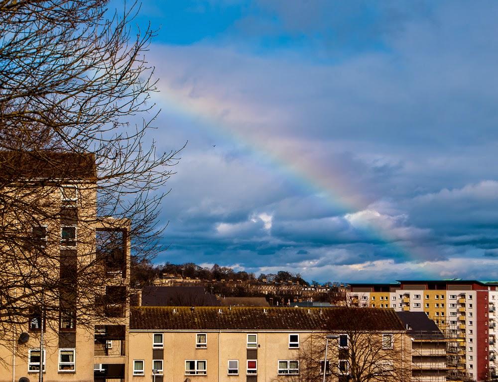 Rainbow after climbing arthur's seat edinburgh