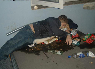 funny picture: drunk in his own vomit