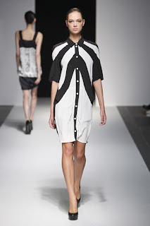 A model wearing a black and white dress on the Devastee catwalk