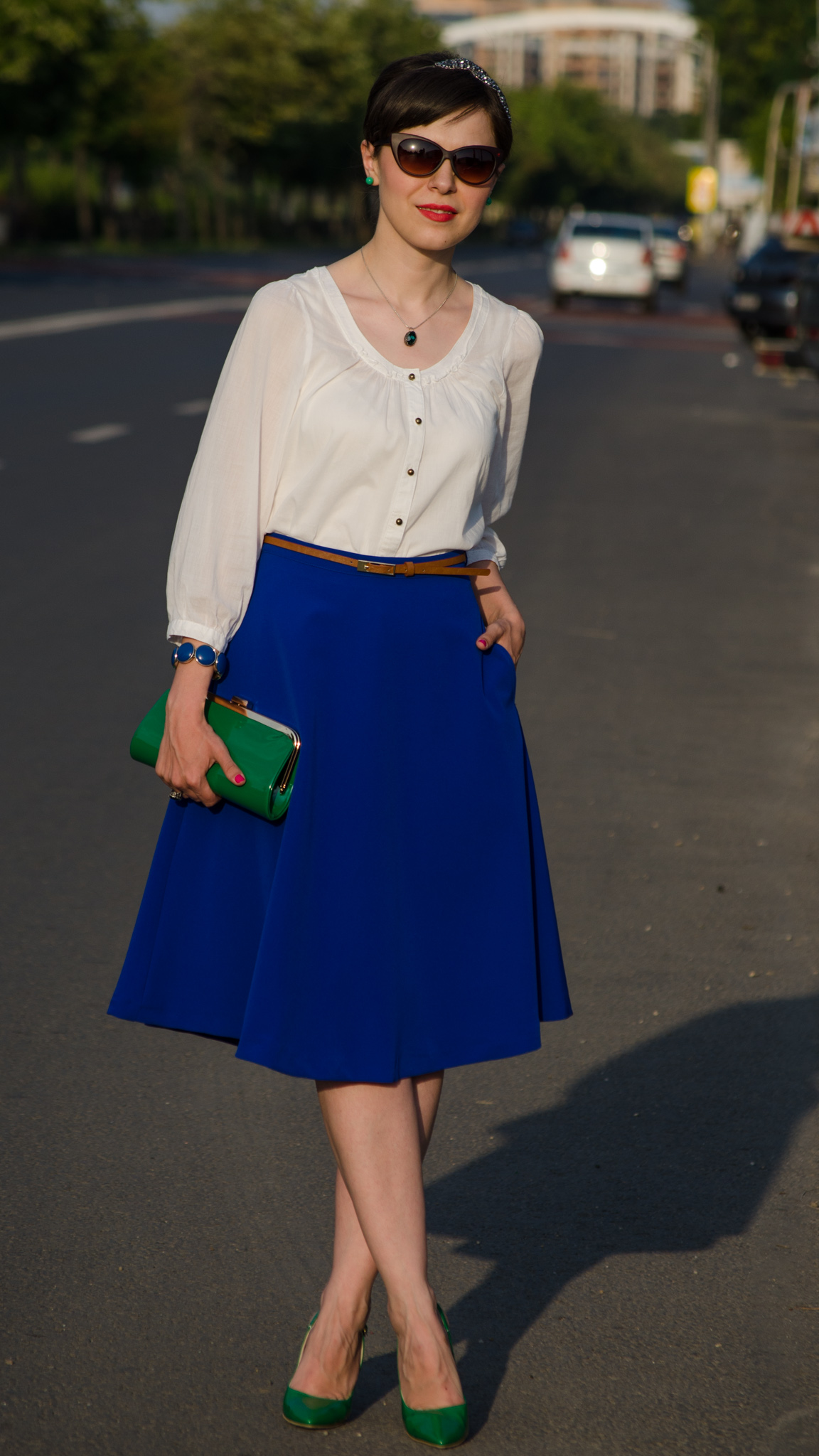 cobalt skirt white shirt emerald green heels emerald green clutch