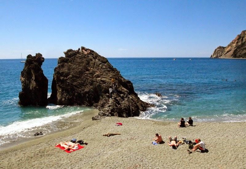 Sunbathing in Monterosso al Mare, Cinque Terre Italy