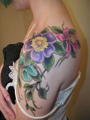 Tattoo images with flowers signify the woman's beauty and charm