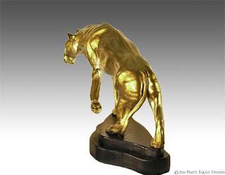 wildlife sculpture, lioness statue, clay art