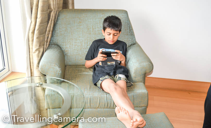 soon as we found out about my husband Alok' conference in Kerala, scheduled for December, we decided that my 9-year-old son, Nishant, and I will also accompany Alok and make it a work plus leisure trip. We planned to extend the stay to 5 days, out of which one day would be reserved for my husband's conference (we could still do some sightseeing in Kochi though) and the rest of the days could be used to explore Kerala a little. I wished we could extend it further, but both my and my husband's jobs don't allow us to take so many leaves. This is one of the disadvantages of being doctors.We reached Kochi early morning on December 4, 2016 and checked into Le Meridien, where the conference was to be held. Since my husband's lecture was scheduled for the next day, we decided to utilize the day and take a day tour on a houseboat through the backwaters. We boarded the houseboat from Alleppey and relaxed as the boat navigated the still waters. We sailed through paddy fields, quaint villages, mesmerizing skylines, and stunning landscapes. The houseboat was almost like a floating house. It had a bedroom, a dining room, a dock, and a clean western style washroom. Apart from the person who was steering the boat, there was a cook too and he cooked delicious Kerala food for us as we travelled. It was pure luxury, sitting on the dock and being served hot, aromatic curry.Before we boarded the houseboat, we were worried that it might get boring for our son, all that sitting around doing nothing. But we were wrong. He enjoyed himself thoroughly and busied himself with photography.After our tour ended at 5pm, we rushed and headed straight for Allepey  beach. As we reached there, it started raining, but we were too excited to go back to the hotel so soon. My husband and I have stayed near the sea for several years, but our son was seeing it for the first time. And his reaction didn't disappoint me. I had hoped that he will be overwhelmed and excited, and there he was jumping through the 