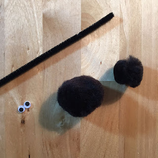Black pom poms, black pipe cleaner chenille stem, googly eyes