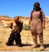 An ISIS member prepares to behead Syrian soldier. (Screen capture from YouTube video)