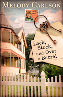 cover of Lock, Stock and Over a Barrel by Melody Carlson shows a Victorian cottage, white picket fence and a set of old keys