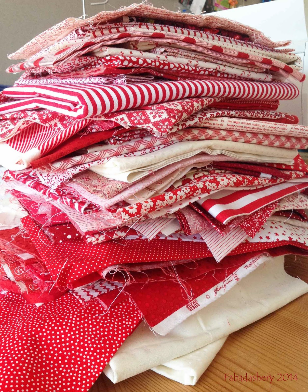 Red and white fabric stash