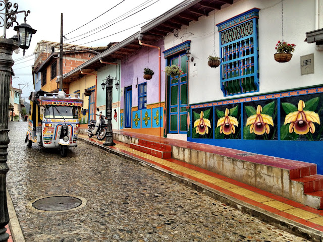 Colourful tuk-tuks in colourful Guatape