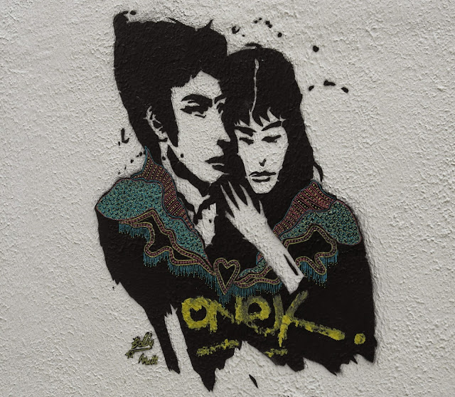 Paris street art graffiti Spanish couple