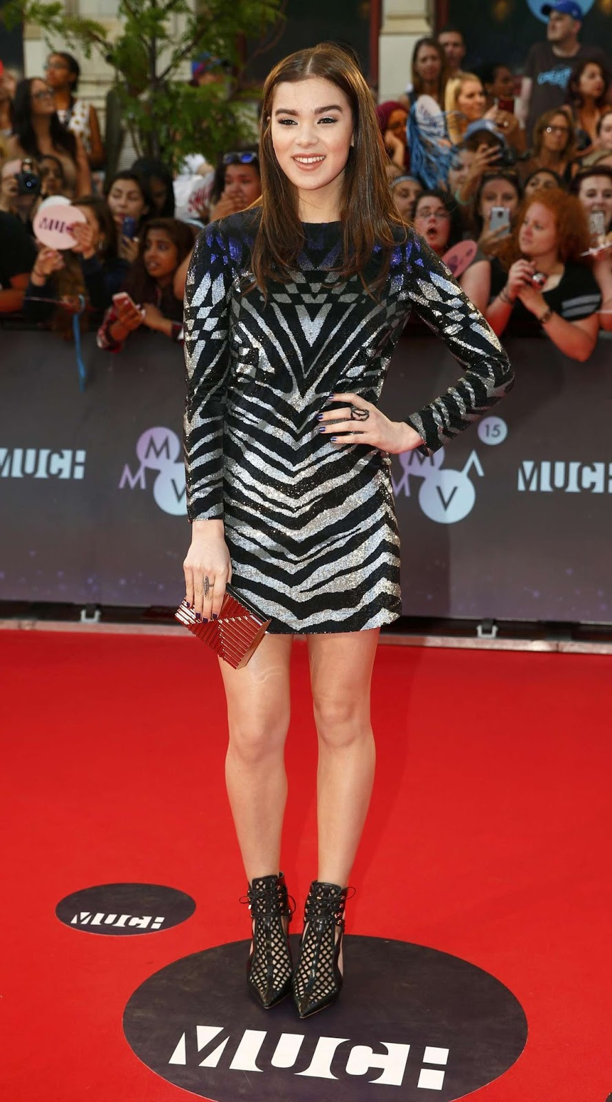 Hailee Steinfeld attends the 2015 MuchMusic Video Awards in Toronto, Canada in an Emilio Pucci zebra print sequin mini dress